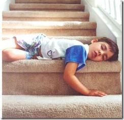 child-asleep-on-stairs